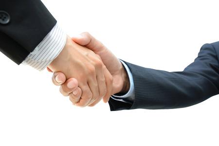handclasp: Handshake of businessmen on white background