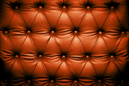 luxurious sofa: Orange brown leather texture with buttoned pattern Stock Photo