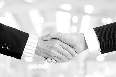 black hand: Handshake of businessmen in black and white (monochrome) Stock Photo