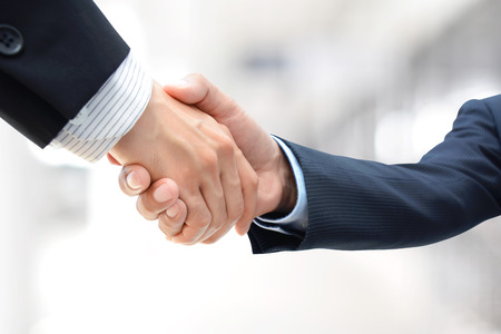 business  deal: Handshake of businessmen - greeting , dealing, merger & acquisition concepts