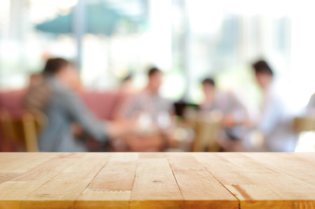 deck: Wood table top with blurred people in cafe as background - can be used for montage or display your products