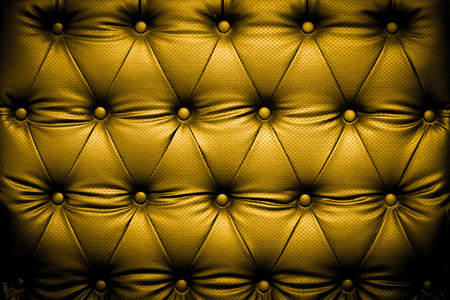 buttoned: Luxury golden leather texture with buttoned pattern Stock Photo