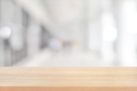 Wood table top on blurred hallway background - can be used for display or montage your products