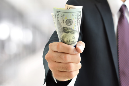 us dollar bill: Businessman hand grabbing money, US dollar (USD) bills