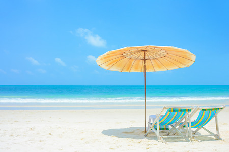 sunny beach: Blue sea and white sand beach with beach chairs and parasol at Samed island, Thailand - holiday and vocation concepts Stock Photo