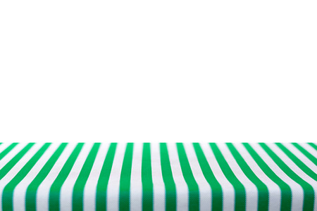tela blanca: Table top covered with green and white stripped tablecloth