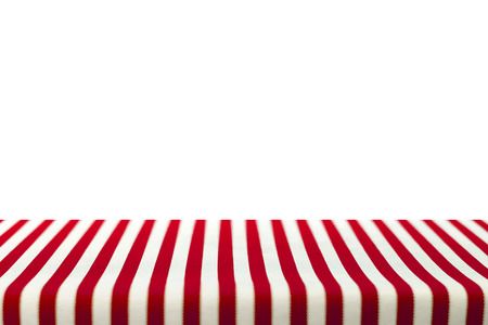 tablecloth: Table top covered with red and white stripped tablecloth Stock Photo