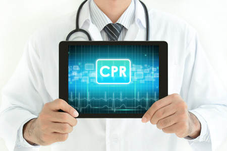 cpr: Doctor holding tablet pc with CPR sign on screen Stock Photo