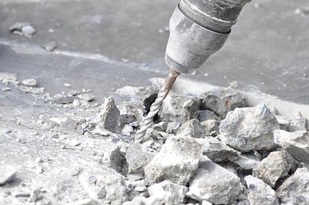 Drilling machine breaking concrete floor