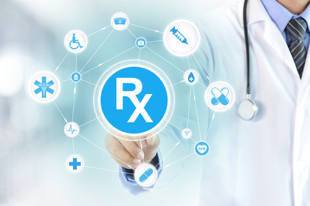 medical symbol: Doctor hand touching Rx sign on virtual screen Stock Photo