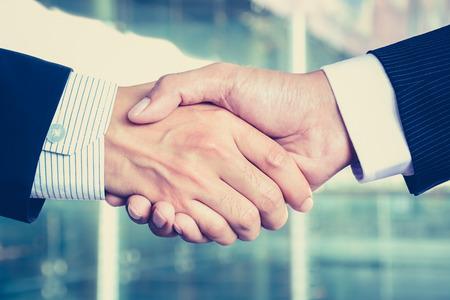 handclasp: Handshake of businessmen, vintage tone - congratulation, greeting & business partner concepts