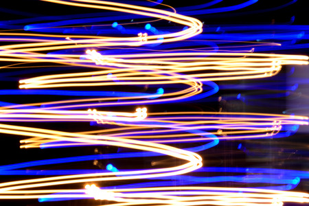 light streaks: Colorful light streaks at night (long exposure shot) - abstract background Stock Photo