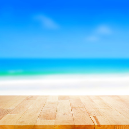 sunny beach: Wood table top on blurred beach background, summer concept  - can be used for display or montage your products