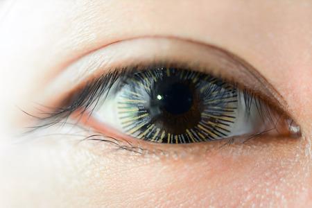 big eye: Close up of woman eye wearing fancy contact lens