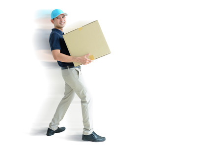 deliveryman: Deliveryman carrying a cardboard box on white background with copy space Stock Photo