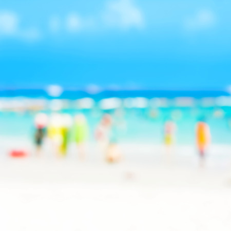 used clothes: Blurred beach with people in colorful clothes can be used as background