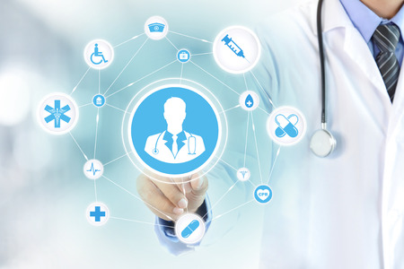Hand touching doctor icon on virtual screen - modern healthcare and medical concepts. Stock Photo