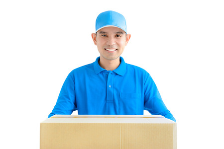 deliveryman: Deliveryman giving a cardboard parcel box - isolated on white background