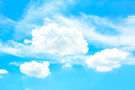 white clouds: White puffy clouds on bright summer blue sky background