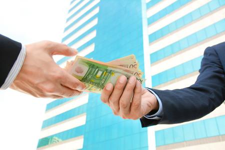 eur: Businessman hands passing money - Euro currency (EUR)
