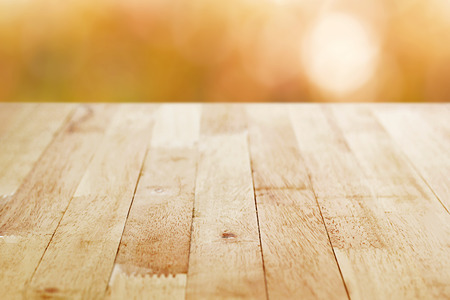 earth tone: Wood table top on brown bokeh background - can be used for montage or display your products Stock Photo