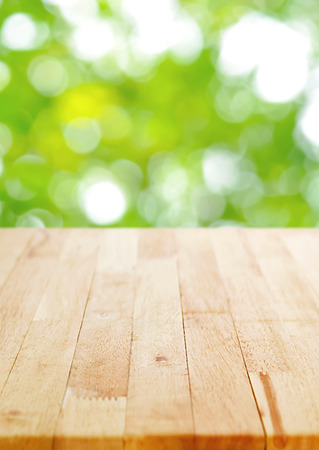 table wood: Wood table top on blur green bokeh background, poster size proportion - can be used for montage or display your products