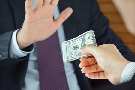 honest: Businessman refusing money, uncorrupted concept - soft focused Stock Photo