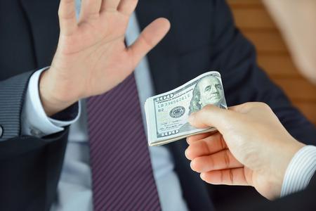 no money: Businessman refusing money, uncorrupted concept - soft focused Stock Photo