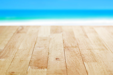Wood table top on blur blue sea and white sand beach background, summer concept - can be used for display or montage your products Stock Photo
