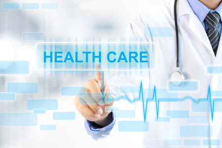 health  healthcare: Doctor hand touching HEALTH CARE sign on virtual screen