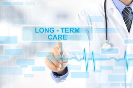 long life: Doctor hand touching LONG - TERM CARE sign on virtual screen