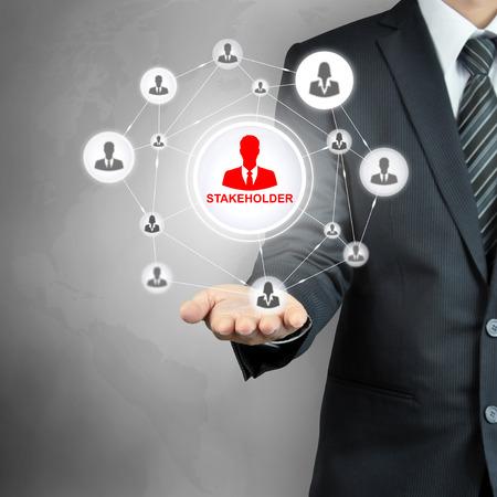 grupo de hombres: Signo ACCIONISTA conectado con el icono de los empresarios de la red en la mano de negocios