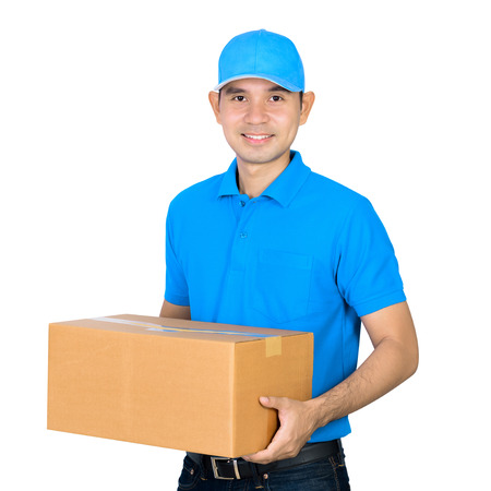 deliveryman: Deliveryman carrying a cardboard parcel box, isolated on white background Stock Photo