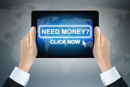 convinced: Hands holding tablet PC with message, NEED MONEY ? CLICK NOW on screen - money online concept Stock Photo