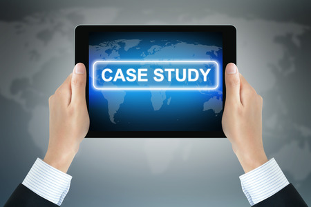computer case: CASE STUDY text on tablet pc screen held by businessman hands Stock Photo