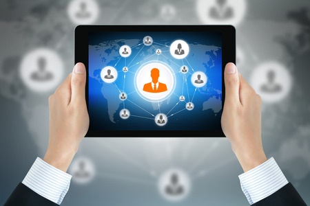 linked hands: Businessman hands holding tablet pc with businesspeople icons linked as network on the screen - business & social network concepts Stock Photo