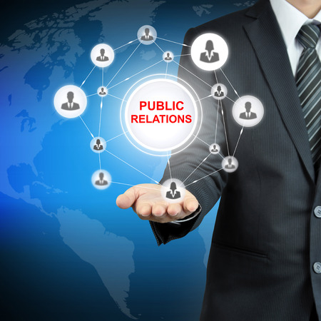 public relations: PUBLIC RELATIONS sign with people icons linked as network on businessman hand