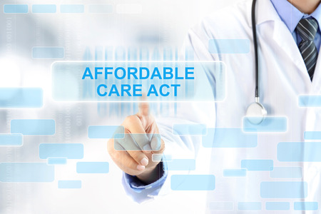 medical care: Doctor hand touching AFFORDABLE CARE ACT sign on virtual screen Stock Photo