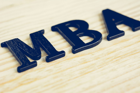 business administration: MBA (or Master of Business Administration) sign on wood background