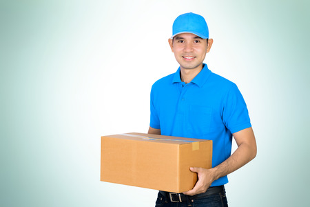 delivery box: Deliveryman carrying a cardboard parcel box on gradient white green background