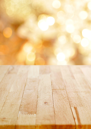 Wood table top on shiny bokeh gold background, poster size proportion - can be used for display or montage your products