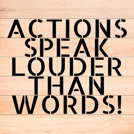 louder: ACTIONS SPEAK LOUDER THAN WORDS text on wood background Stock Photo