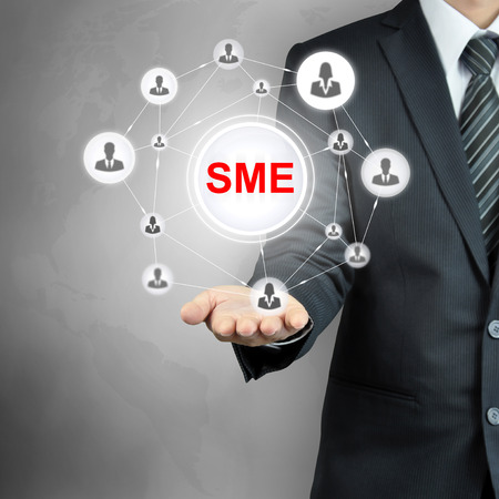 company job: SME (or Small and Medium Enterprises) sign with people icon network on businessman hand