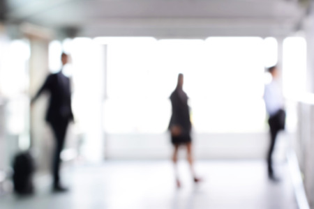 business people: Blurred business people standing in building hall , can be used as abstract background