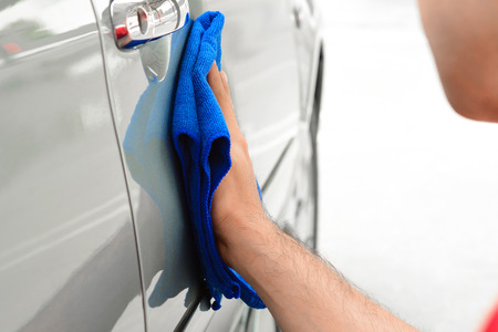 wash cloth: A man hand cleaning car with microfiber cloth