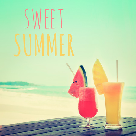 slush: Colorful fruit smoothie drinks at the beach with SWEET SUMMER text, vintage tone Stock Photo