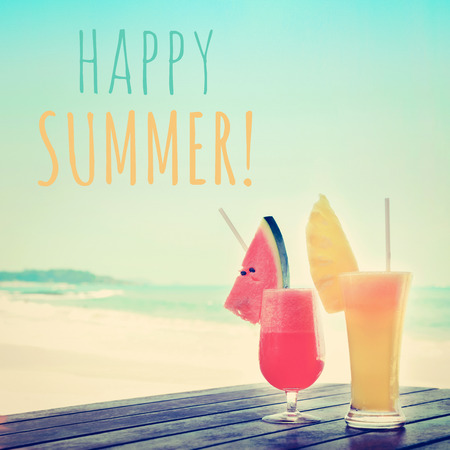 summer fruit: Colorful fruit smoothie drinks at the beach with HAPPY SUMMER text Stock Photo
