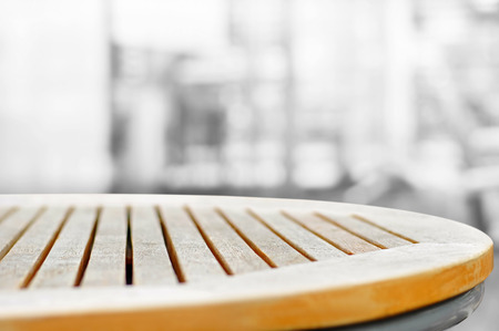 Round wood table top on blur gray abstract background - can be used for display or montage your products Stock Photo