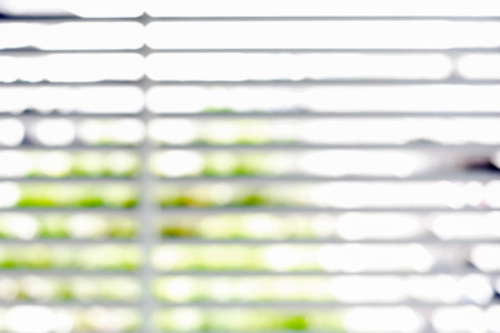 green abstract background: Blurred window blind for background Stock Photo