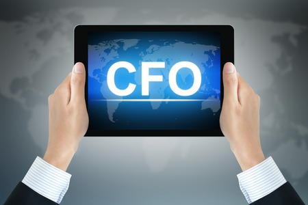 cfo: CFO (or Chief Financial Officer) sign on tablet pc screen held by businessman hands Stock Photo
